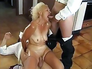Old lady�s ass is pounded heavily by two impudent service guys