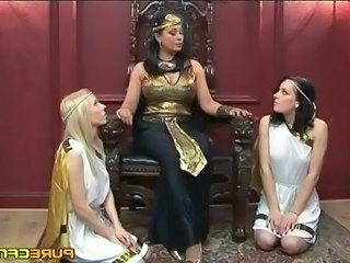 Queen Cleopatra orders her hand maidens to wank the slave's coconuts dry