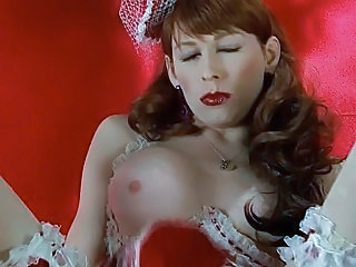 Redhead Tranny Tara Slides a Dildo In and Out of Her Ass