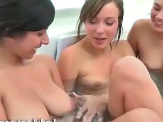 Three naked teens explore lesbian sex in a bath tub and start kissing each other