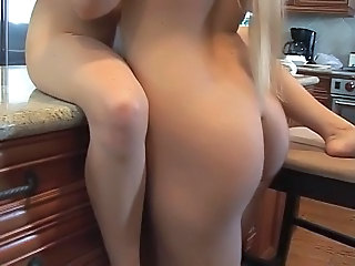 Blonde gets turned on by her hot girlfriend in the kitchen
