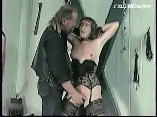 Master puts metal clamps on nipples of slave and plays with