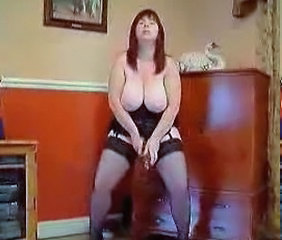 Busty red head masturbating in stockings