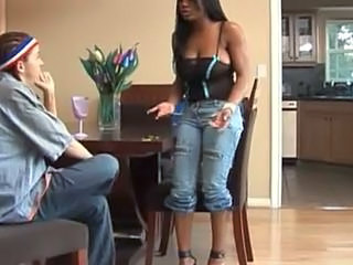 Ebony and white girl have an orgasm together with strapon