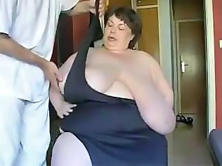 Fat brunette granny with humongous tits is showing them off
