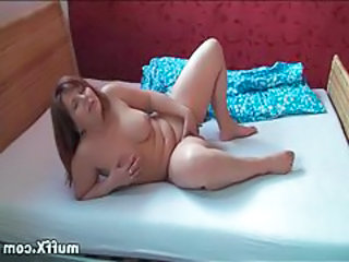 Voluptuous beauty happily fingers her pussy tubes