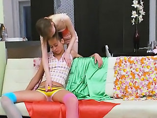Two russian girls play with strong man