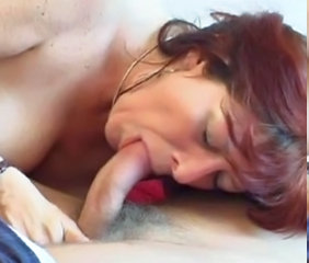 Redhead Granny in Stockings Fucks the Boy