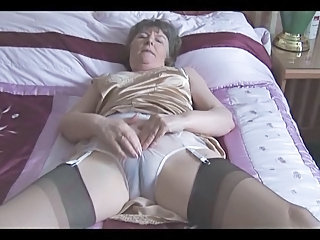 Hairy granny in slip and stockings