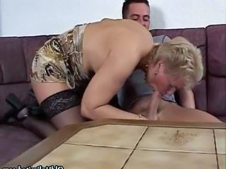 Horny blonde granny in stockings sucking