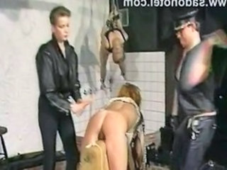"Slave is spanked hard on her ass while a other who is..."" target=""_blank"