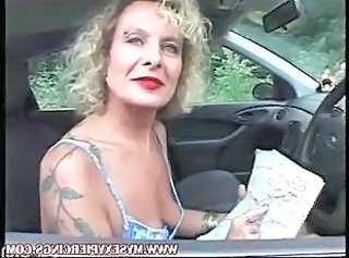 MILF with pierced pussy and nipples masturbating in the car