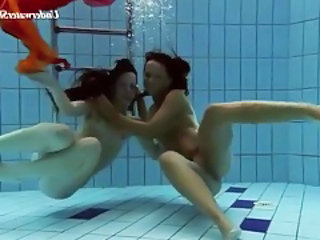 Two beautiful girls swim in the nude tubes