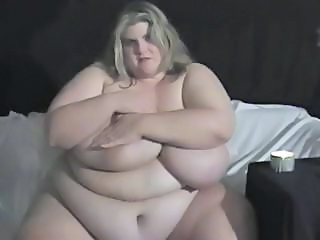Really fat blonde has huge boobs and plays with them on webcam