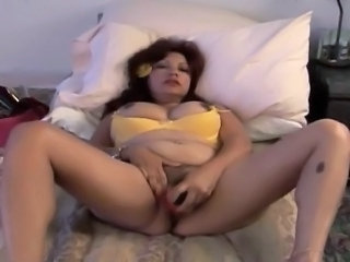 Sexy hispanic cougar with big tits frigs her pussy in front of the webcam