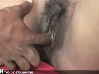 Amateur indian is down on her knees sucking Dick