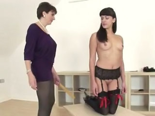 Fetish lezdom mature Lady Sonia spanks hottie