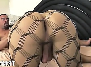 Skinny tranny plays with cock