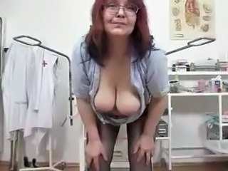 Old ginger pussy close to Glasses teases Her hirsute twat