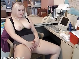 Chubby blonde secretary gets horny at work and plays with