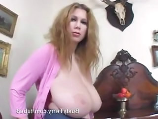 Busty broad Terry has some huge tits and she proudly shows them off