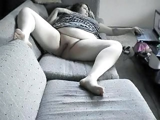 BBW rubbing shaved pussy while watching porn