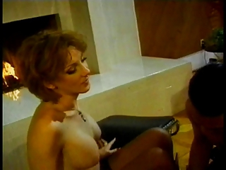 Guy gets on his knees and sucks trannys cock and tits