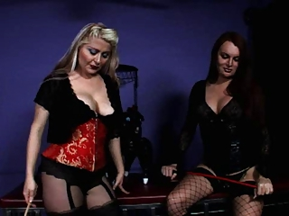 Gorgeous mistress and shemale dominates slave