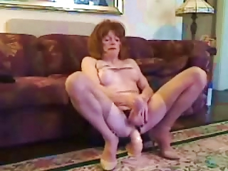 Mature CD takes a huge dildo in her ass