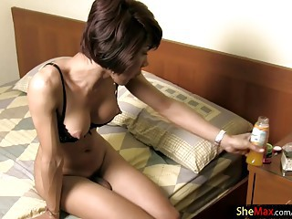 Short hair Thai tranny jerks off while getting anal fucked