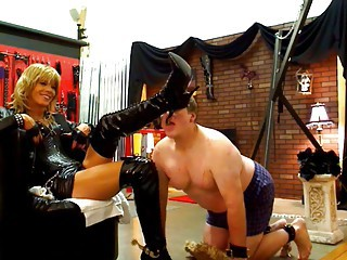 shemale domina thigh high boots and spurs