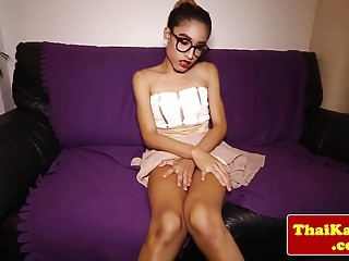 Thai ladyboy with glasses stimulating solo show