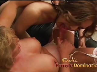 Mature blonde dominating a uber-sexy shemale with a big strap-on