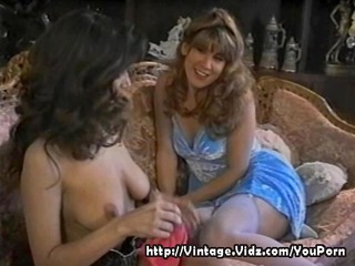 vintage lesbians play on the sofa