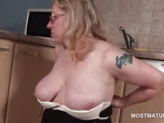 Orgasm craving mature blonde sucking a vibrator on floor