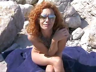 Old red haired mommy from Spain gets teamed by two hung sunbathers