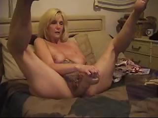 Mature blondie sticks a monstrous sex toy and her fist deep into her cunt