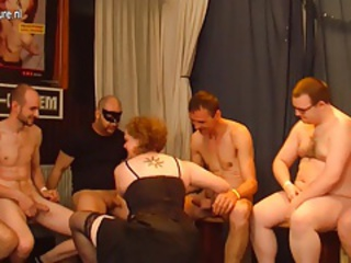 Kinky old German housewife in a crazy gangbang