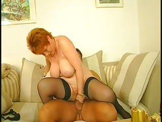 Redhead Granny in Stockings Fucks