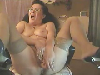 My 62 years old mom masturbating at computer. Stolen video