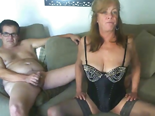 Sexy mature lady in corset gives great blow job