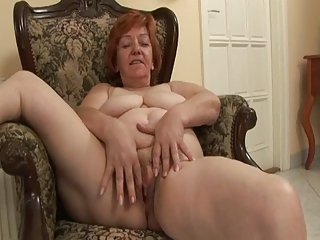 Old lady franticly rubbing her hairy pussy