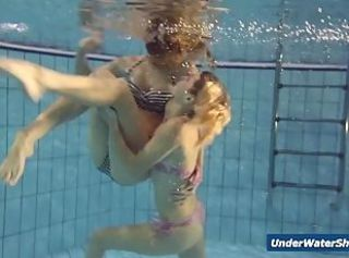 Horny girls strip eachother in the pool